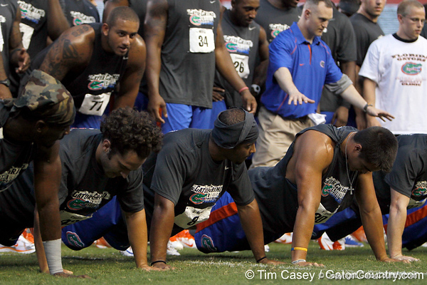 Florida redshirt junior cornerback Jeremy Brown does a push-up during the Gator Charity Challenge event on Friday, July 29, 2011 at Ben Hill Griffin Stadium in Gainesville, Fla. / Gator Country photo by Tim Casey