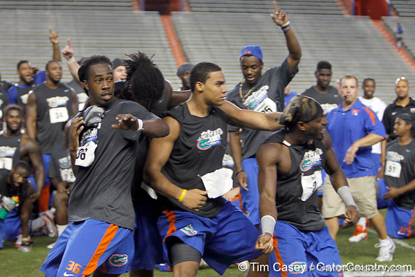 "Team ""Against All Odds"" celebrates during the Gator Charity Challenge event on Friday, July 29, 2011 at Ben Hill Griffin Stadium in Gainesville, Fla. / Gator Country photo by Tim Casey"