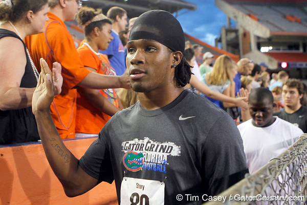 Florida freshman receiver Ja'Juan Story slaps hands with fans during the Gator Charity Challenge event on Friday, July 29, 2011 at Ben Hill Griffin Stadium in Gainesville, Fla. / Gator Country photo by Tim Casey