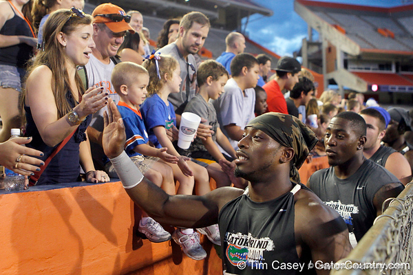 Florida senior running back Jeff Demps slaps hands with fans  during the Gator Charity Challenge event on Friday, July 29, 2011 at Ben Hill Griffin Stadium in Gainesville, Fla. / Gator Country photo by Tim Casey