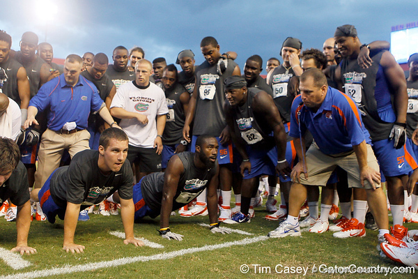Florida sophomore fullback Jesse Schmitt and Florida redshirt senior running back/receiver Chris Rainey do push-ups during the Gator Charity Challenge event on Friday, July 29, 2011 at Ben Hill Griffin Stadium in Gainesville, Fla. / Gator Country photo by Tim Casey