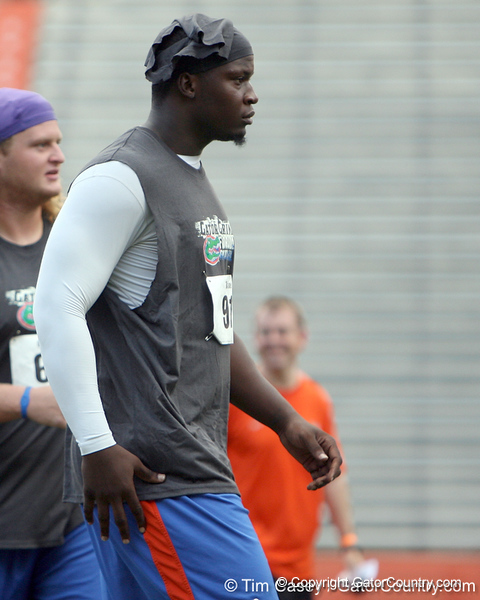 Florida redshirt junior defensive end Earl Okine walks across the field during the Gator Charity Challenge event on Friday, July 29, 2011 at Ben Hill Griffin Stadium in Gainesville, Fla. / Gator Country photo by Tim Casey