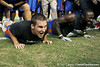 Florida sophomore fullback Jesse Schmitt does a push-up during the Gator Charity Challenge event on Friday, July 29, 2011 at Ben Hill Griffin Stadium in Gainesville, Fla. / Gator Country photo by Tim Casey