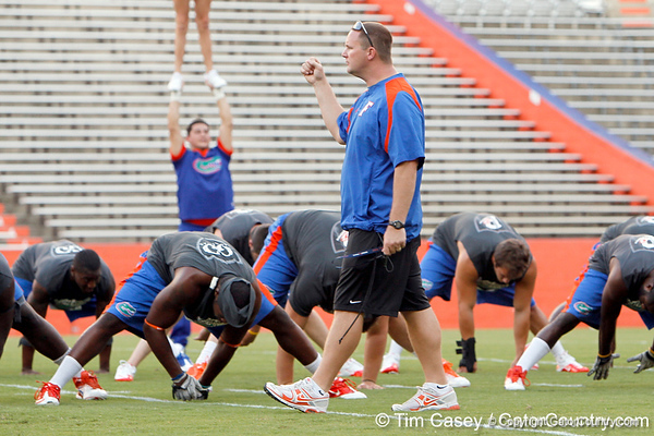 Florida baseball strength & conditioning coordinator Paul Chandler helps oversee warmups during the Gator Charity Challenge event on Friday, July 29, 2011 at Ben Hill Griffin Stadium in Gainesville, Fla. / Gator Country photo by Tim Casey