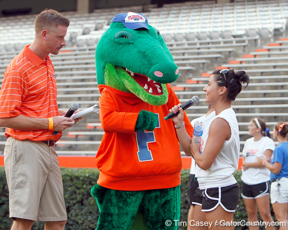 Jeff Cardozo and Albert interview Florida gymnast Marissa King during the Gator Charity Challenge event on Friday, July 29, 2011 at Ben Hill Griffin Stadium in Gainesville, Fla. / Gator Country photo by Tim Casey