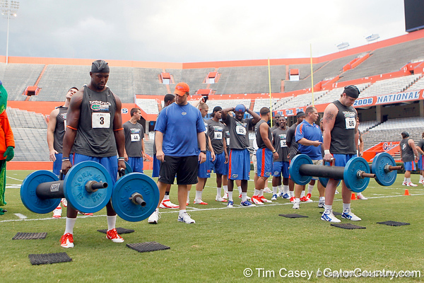 Jelani Jenkins and Dan Wender compete in the torpedo hold during the Gator Charity Challenge event on Friday, July 29, 2011 at Ben Hill Griffin Stadium in Gainesville, Fla. / Gator Country photo by Tim Casey