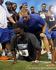 Gary Beemer encourages Florida redshirt senior cornerback Moses Jenkins during the Gator Charity Challenge event on Friday, July 29, 2011 at Ben Hill Griffin Stadium in Gainesville, Fla. / Gator Country photo by Tim Casey