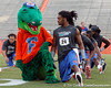 Albert and Florida junior free safety Josh Evans stretch during the Gator Charity Challenge event on Friday, July 29, 2011 at Ben Hill Griffin Stadium in Gainesville, Fla. / Gator Country photo by Tim Casey
