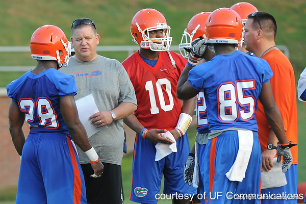 Florida offensive coordinator/quarterbacks coach Charlie Weis talks with Jeff Demps during the Gators' football practice on Saturday, August 6, 2011 at Donald R. Dizney Stadium in Gainesville, Fla. / photo courtesy of UF Communications