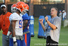 Florida redshirt sophomore defensive tackle Kedric Johnson listens to linebackers coach/special teams coordinator D.J. Durkin during the Gators' football practice on Saturday, August 6, 2011 at Donald R. Dizney Stadium in Gainesville, Fla. / photo courtesy of UF Communications