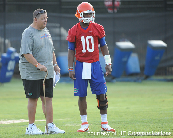 Florida offensive coordinator/quarterbacks coach Charlie Weis talks with redshirt freshman quarterback Tyler Murphy during the Gators' football practice on Saturday, August 6, 2011 at Donald R. Dizney Stadium in Gainesville, Fla. / photo courtesy of UF Communications