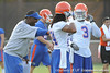Florida tight ends coach Derek Lewis talks with Josh Evans and Jelani Jenkins during the Gators' football practice on Saturday, August 6, 2011 at Donald R. Dizney Stadium in Gainesville, Fla. / photo courtesy of UF Communications