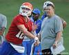 Florida redshirt senior quarterback John Brantley passes as offensive coordinator/quarterbacks coach Charlie Weis watches during the Gators' football practice on Saturday, August 6, 2011 at Donald R. Dizney Stadium in Gainesville, Fla. / photo courtesy of UF Communications