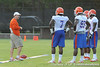 Florida head coach Will Muschamp talks with members of the defensive line during the Gators' football practice on Saturday, August 6, 2011 at Donald R. Dizney Stadium in Gainesville, Fla. / photo courtesy of UF Communications