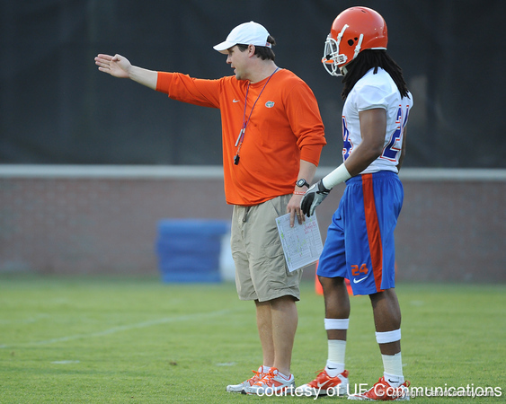 Florida head coach Will Muschamp talks with junior free safety Josh Evans during the Gators' football practice on Saturday, August 6, 2011 at Donald R. Dizney Stadium in Gainesville, Fla. / photo courtesy of UF Communications