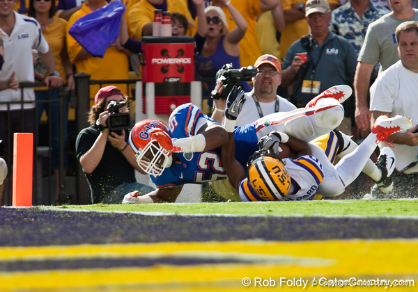 LSU wide receiver Russell Shepard gets tackled by Florida junior linebacker Jonathan Bostic during the Gators' 41-11 loss to the LSU Tigers on Saturday, October 8, 2011 at Tiger Stadium in Baton Rouge, La. / Gator Country photo by Rob Foldy