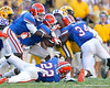 Florida redshirt junior defensive end Lerentee McCray and Florida freshman cornerback Marcus Roberson tackle Spencer Ware during the fourth quarter of the Gators' 41-11 loss to the LSU Tigers on Saturday, October 8, 2011 at Tiger Stadium in Baton Rouge, La. / Gator Country photo by Tim Casey