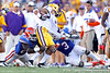 Florida sophomore safety Matt Elam and redshirt sophomore linebacker Jelani Jenkins tackle Tyrann Mathieu on a punt return during the third quarter of the Gators' 41-11 loss to the LSU Tigers on Saturday, October 8, 2011 at Tiger Stadium in Baton Rouge, La. / Gator Country photo by Tim Casey