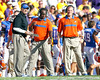 Florida defensive coordinator/defensive line coach Dan Quinn and defensive backs coach Travaris Robinson watch from the sideline during the third quarter of the Gators' 41-11 loss to the LSU Tigers on Saturday, October 8, 2011 at Tiger Stadium in Baton Rouge, La. / Gator Country photo by Tim Casey