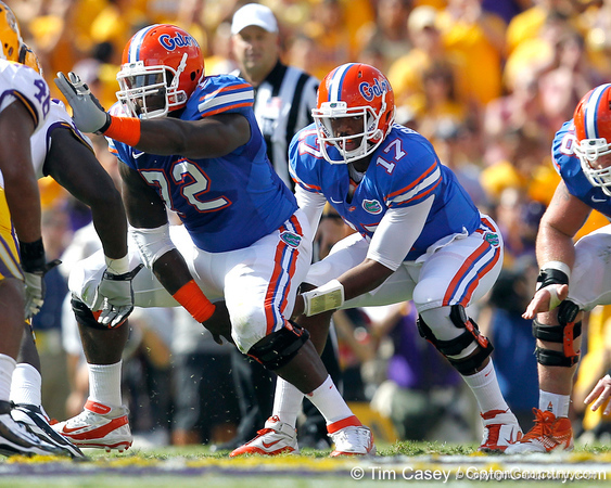 Florida redshirt sophomore center Jonotthan Harrison snaps the ball to freshman quarterback Jacoby Brissett during the first quarter of the Gators' 41-11 loss to the LSU Tigers on Saturday, October 8, 2011 at Tiger Stadium in Baton Rouge, La. / Gator Country photo by Tim Casey