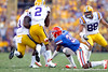 Florida sophomore cornerback Cody Riggs attempts to tackle Rueben Randle during the third quarter of the Gators' 41-11 loss to the LSU Tigers on Saturday, October 8, 2011 at Tiger Stadium in Baton Rouge, La. / Gator Country photo by Tim Casey