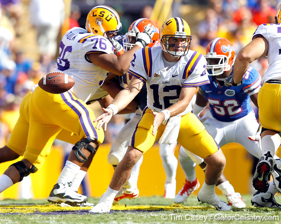 LSU quarterback Jarrett Lee pitches the ball during the second quarter of the Gators' 41-11 loss to the LSU Tigers on Saturday, October 8, 2011 at Tiger Stadium in Baton Rouge, La. / Gator Country photo by Tim Casey