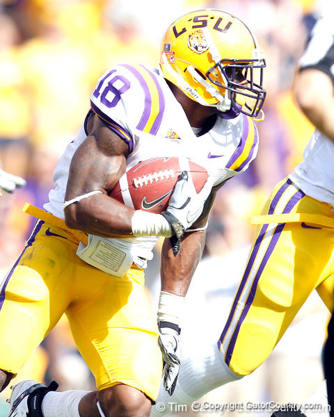 LSU safety Brandon Taylor returns an interception 17 yards during the second quarter of the Gators' 41-11 loss to the LSU Tigers on Saturday, October 8, 2011 at Tiger Stadium in Baton Rouge, La. / Gator Country photo by Tim Casey
