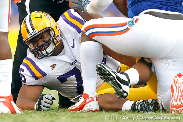 Chris Faulk gets caught under a pile during the third quarter of the Gators' 41-11 loss to the LSU Tigers on Saturday, October 8, 2011 at Tiger Stadium in Baton Rouge, La. / Gator Country photo by Tim Casey