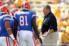 Florida offensive coordinator/quarterbacks coach Charlie Weis talks with players before the Gators' 41-11 loss to the LSU Tigers on Saturday, October 8, 2011 at Tiger Stadium in Baton Rouge, La. / Gator Country photo by Tim Casey