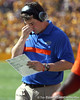 Florida head coach Will Muschamp looks at his play sheet during the second quarter of the Gators' 41-11 loss to the LSU Tigers on Saturday, October 8, 2011 at Tiger Stadium in Baton Rouge, La. / Gator Country photo by Tim Casey