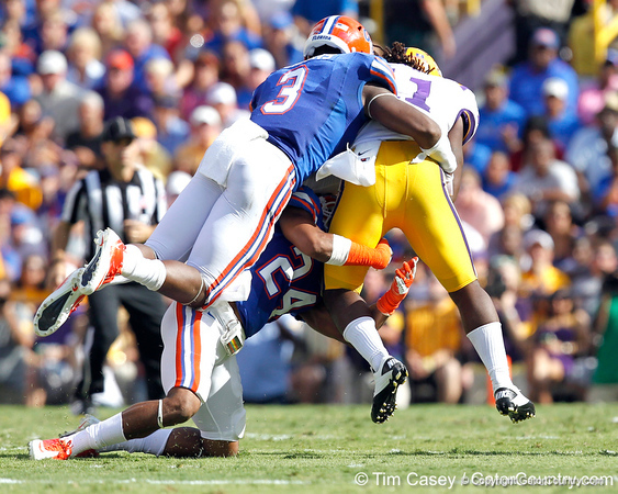 Florida redshirt sophomore linebacker Jelani Jenkins and junior free safety Josh Evans tackle Spencer Ware during the second quarter of the Gators' 41-11 loss to the LSU Tigers on Saturday, October 8, 2011 at Tiger Stadium in Baton Rouge, La. / Gator Country photo by Tim Casey