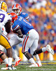 Florida sophomore running back Trey Burton hands the ball to Chris Rainey during the second quarter of the Gators' 41-11 loss to the LSU Tigers on Saturday, October 8, 2011 at Tiger Stadium in Baton Rouge, La. / Gator Country photo by Tim Casey