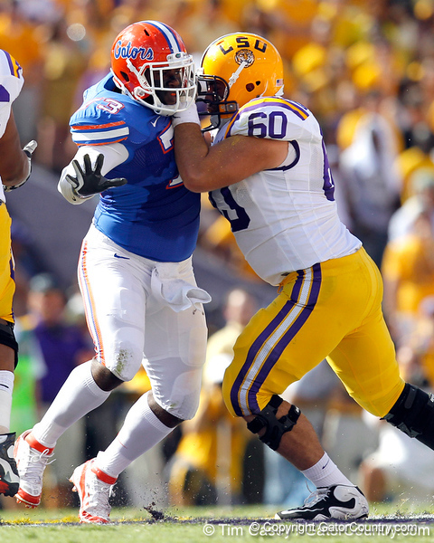Florida sophomore defensive tackle Sharrif Floyd fights a block during the first quarter of the Gators' 41-11 loss to the LSU Tigers on Saturday, October 8, 2011 at Tiger Stadium in Baton Rouge, La. / Gator Country photo by Tim Casey