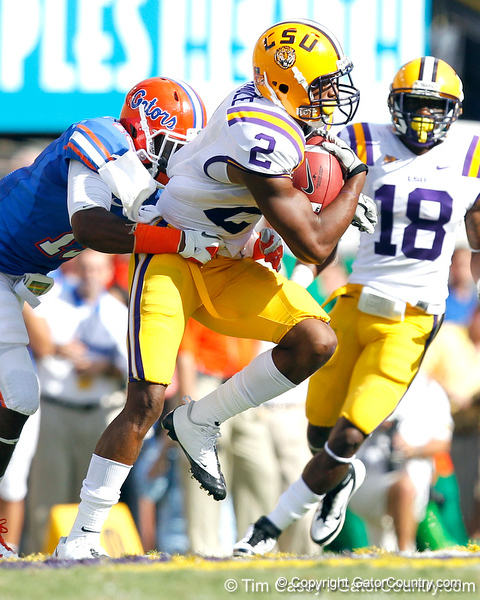 Florida freshman cornerback Loucheiz Purifoy tackles Rueben Randle on a punt return during the second quarter of the Gators' 41-11 loss to the LSU Tigers on Saturday, October 8, 2011 at Tiger Stadium in Baton Rouge, La. / Gator Country photo by Tim Casey