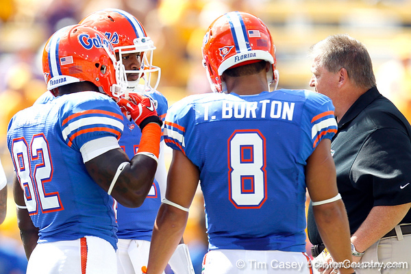 Florida freshman quarterback Jacoby Brissett talks with offensive coordinator/quarterbacks coach Charlie Weis before the Gators' 41-11 loss to the LSU Tigers on Saturday, October 8, 2011 at Tiger Stadium in Baton Rouge, La. / Gator Country photo by Tim Casey