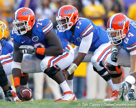 Florida redshirt sophomore center Jonotthan Harrison snaps the ball to freshman quarterback Jacoby Brissett during the fourth quarter of the Gators' 41-11 loss to the LSU Tigers on Saturday, October 8, 2011 at Tiger Stadium in Baton Rouge, La. / Gator Country photo by Tim Casey