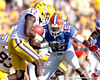 Florida freshman cornerback Loucheiz Purifoy tackles Morris Claiborne after a 14-yard kickoff return during the third quarter of the Gators' 41-11 loss to the LSU Tigers on Saturday, October 8, 2011 at Tiger Stadium in Baton Rouge, La. / Gator Country photo by Tim Casey