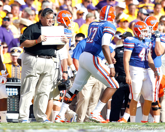 Florida offensive coordinator/quarterbacks coach Charlie Weis talks to freshman quarterback Jacoby Brissett during the second quarter of the Gators' 41-11 loss to the LSU Tigers on Saturday, October 8, 2011 at Tiger Stadium in Baton Rouge, La. / Gator Country photo by Tim Casey