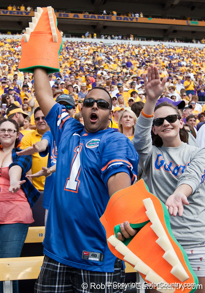Florida fans cheer by doing the chomp before the Gators' 41-11 loss to the LSU Tigers on Saturday, October 8, 2011 at Tiger Stadium in Baton Rouge, La. / Gator Country photo by Rob Foldy