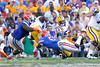 Florida sophomore defensive tackle Sharrif Floyd and redshirt freshman linebacker Michael Taylor tackle Spencer Ware during the third quarter of the Gators' 41-11 loss to the LSU Tigers on Saturday, October 8, 2011 at Tiger Stadium in Baton Rouge, La. / Gator Country photo by Tim Casey