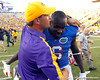 LSU receivers coach Billy Gonzales hugs Florida redshirt senior receiver Deonte Thompson after the Gators' 41-11 loss to the LSU Tigers on Saturday, October 8, 2011 at Tiger Stadium in Baton Rouge, La. / Gator Country photo by Tim Casey