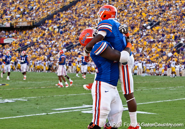Florida redshirt sophomore guard Jonotthan Harrison embraces teammate redshirt sophomore receiver Andre Debose after his touchdown during the Gators' 41-11 loss to the LSU Tigers on Saturday, October 8, 2011 at Tiger Stadium in Baton Rouge, La. / Gator Country photo by Rob Foldy