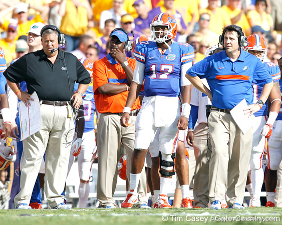 Florida offensive coordinator/quarterbacks coach Charlie Weis, freshman quarterback Jacoby Brissett and head coach Will Muschamp watch from the sideline during the second quarter of the Gators' 41-11 loss to the LSU Tigers on Saturday, October 8, 2011 at Tiger Stadium in Baton Rouge, La. / Gator Country photo by Tim Casey