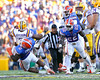 Florida sophomore defensive tackle Dominique Easley and redshirt sophomore linebacker Jelani Jenkins tackle Jordan Jefferson during the third quarter of the Gators' 41-11 loss to the LSU Tigers on Saturday, October 8, 2011 at Tiger Stadium in Baton Rouge, La. / Gator Country photo by Tim Casey