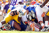 Florida redshirt sophomore guard Jon Halapio lies at the bottom of a pile as sophomore running back Trey Burton converts a fourth down play during the first quarter of the Gators' 41-11 loss to the LSU Tigers on Saturday, October 8, 2011 at Tiger Stadium in Baton Rouge, La. / Gator Country photo by Tim Casey