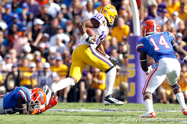 Florida freshman cornerback De'Ante Saunders attempts to tackle Russell Shepard during the second quarter of the Gators' 41-11 loss to the LSU Tigers on Saturday, October 8, 2011 at Tiger Stadium in Baton Rouge, La. / Gator Country photo by Tim Casey