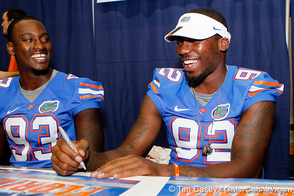 Florida redshirt sophomore defensive tackle Kedric Johnson and redshirt freshman defensive end Lynden Trail laugh during the Gators' annual Fan Day event on Saturday, August 20, 2011 at the Stephen C. O'Connell Center in Gainesville, Fla. / Gator Country photo by Tim Casey