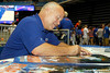Broadcaster Mick Hubert signs an autograph during the Gators' annual Fan Day event on Saturday, August 20, 2011 at the Stephen C. O'Connell Center in Gainesville, Fla. / Gator Country photo by Tim Casey
