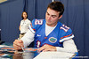 Florida redshirt senior quarterback John Brantley signs an autograph during the Gators' annual Fan Day event on Saturday, August 20, 2011 at the Stephen C. O'Connell Center in Gainesville, Fla. / Gator Country photo by Tim Casey