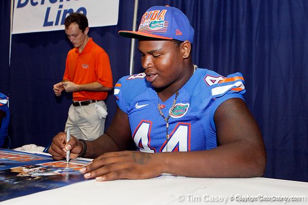 Florida redshirt freshman defensive tackle Leon Orr signs an autograph during the Gators' annual Fan Day event on Saturday, August 20, 2011 at the Stephen C. O'Connell Center in Gainesville, Fla. / Gator Country photo by Tim Casey